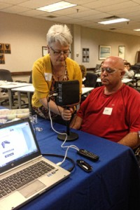 Bev Borst, a Technical Service Specialist for 3M Canada Company, Personal Safety Division sets up an EARfit™ Dual-Ear Validation System demo