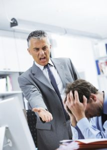 Mature manager shouting at his office worker