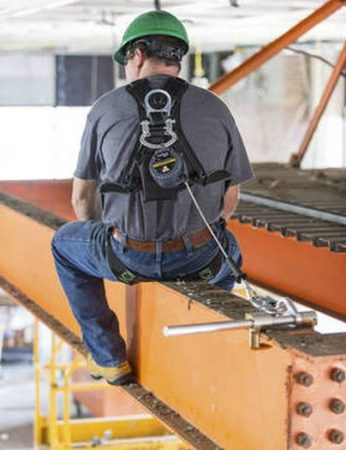 Man sitting on beam wearing honeywell miller turbomax