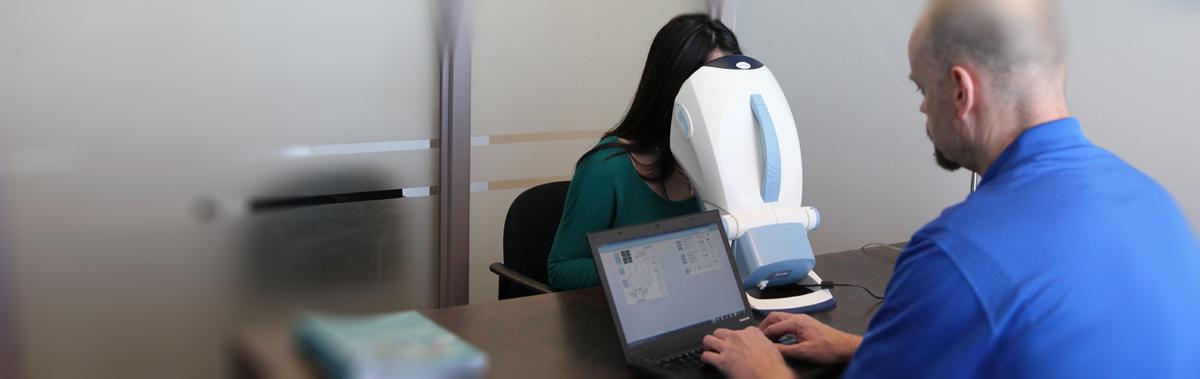 woman looking into a depisteo vision screener