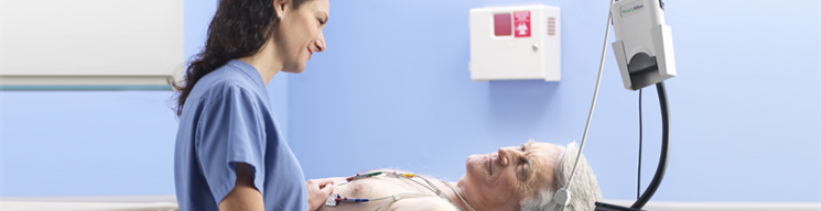 Nurse monitoring patient with an ECG.