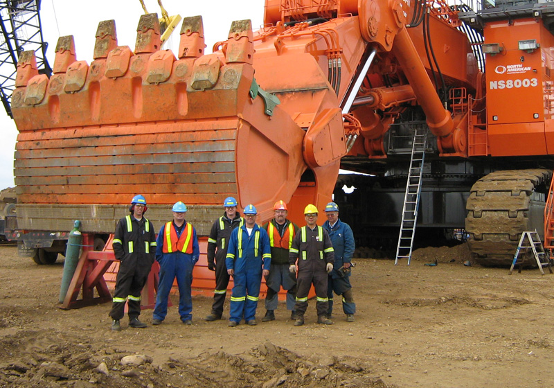 group of miners standing in front of an 8000 shovel