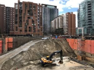 Construction equipment is parked at the bottom of a pit on the site of a new condominium complex off Redpath Avenue in Toronto, Ontario, Canada.