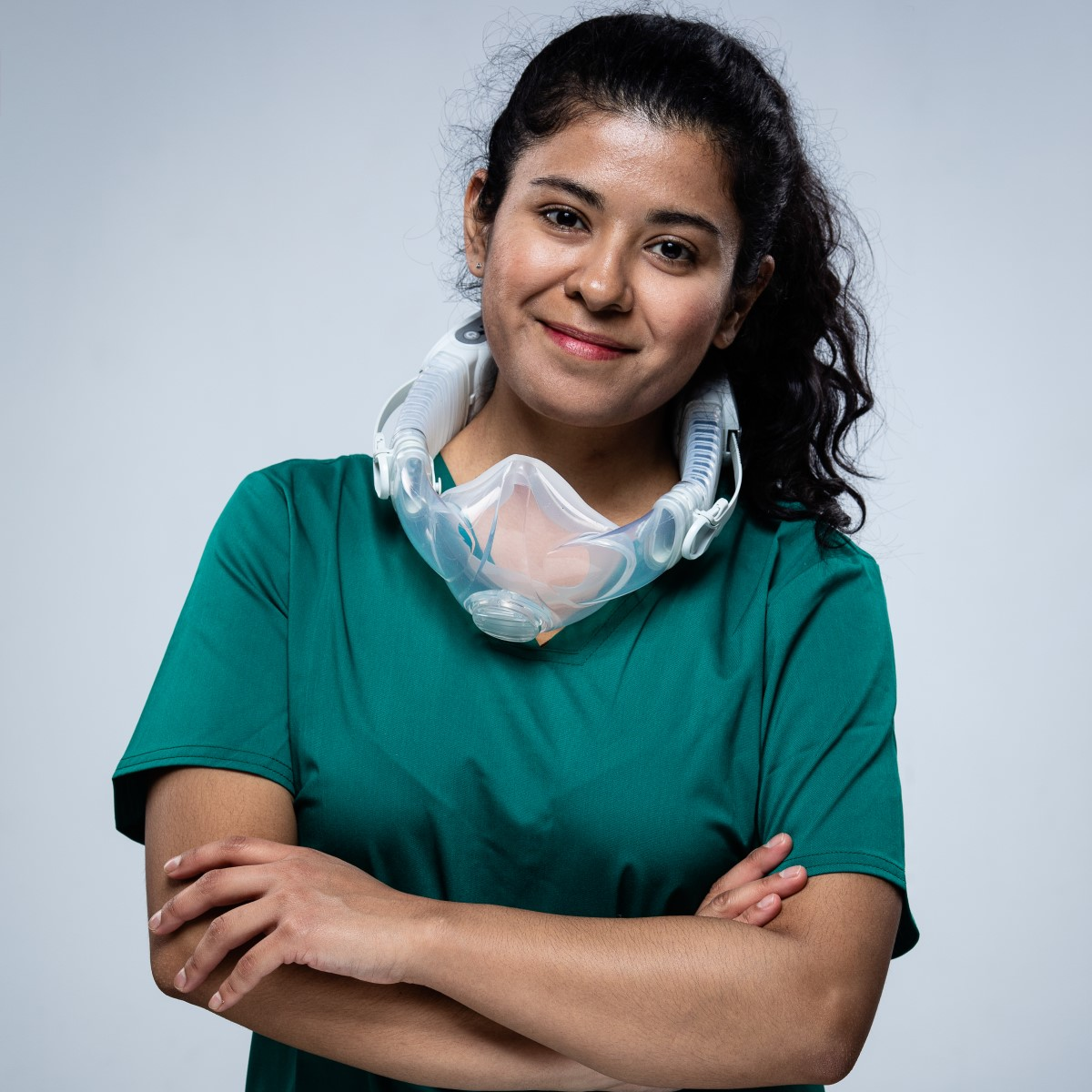 female doctor smiling wearing cleanspace halo around her neck
