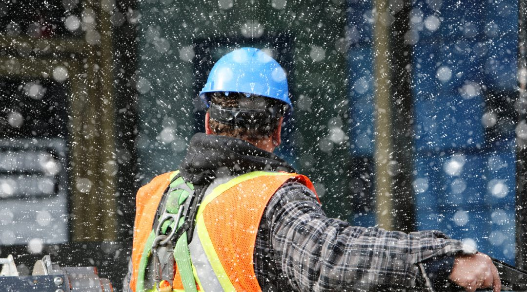 construction worker working in the snow