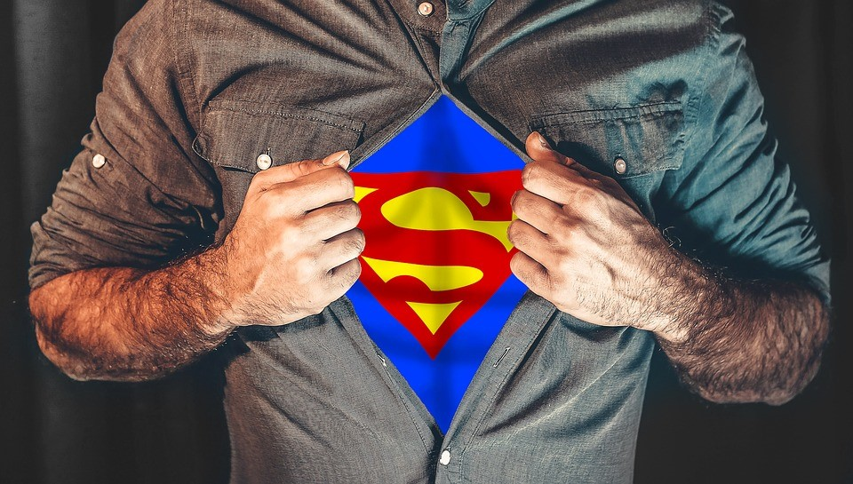 Guy opening shirt to superman logo