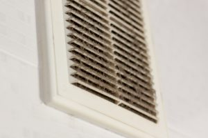 cleaning ventilation plastic dust. the filter is completely clogged with dust and dirt. dirty ventilation in the room. Disinfection service.