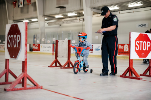 police officer child bike rodeo