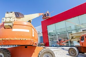 "Zrenjanin, Vojvodina, Serbia – August 27, 2015: Building activities during construction of the large complex shopping mall ""AVIV PARK"" in Zrenjanin city."