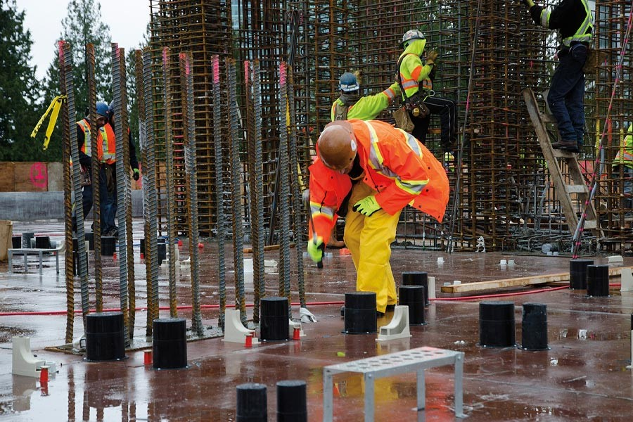 man working on construction site in the rain