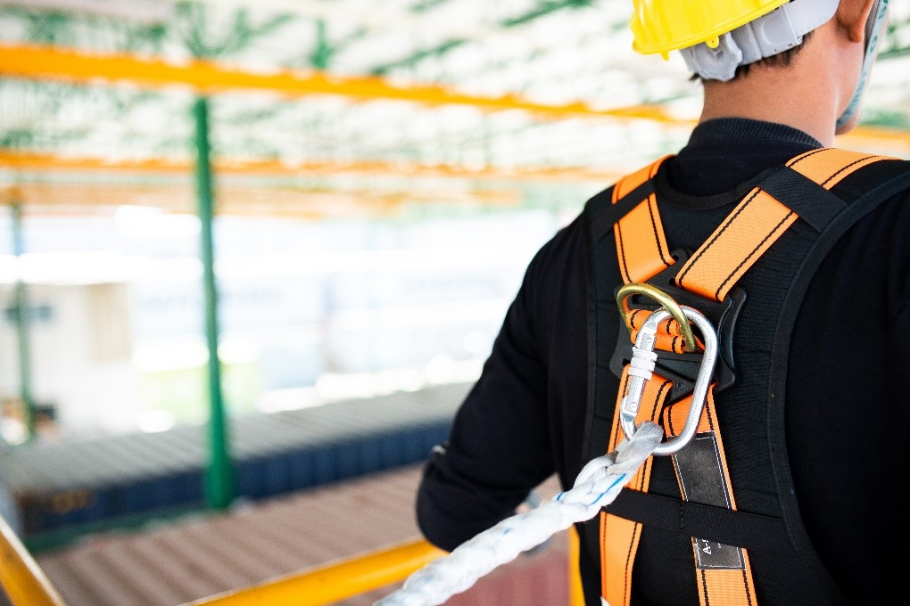 man wearing fall protection harness