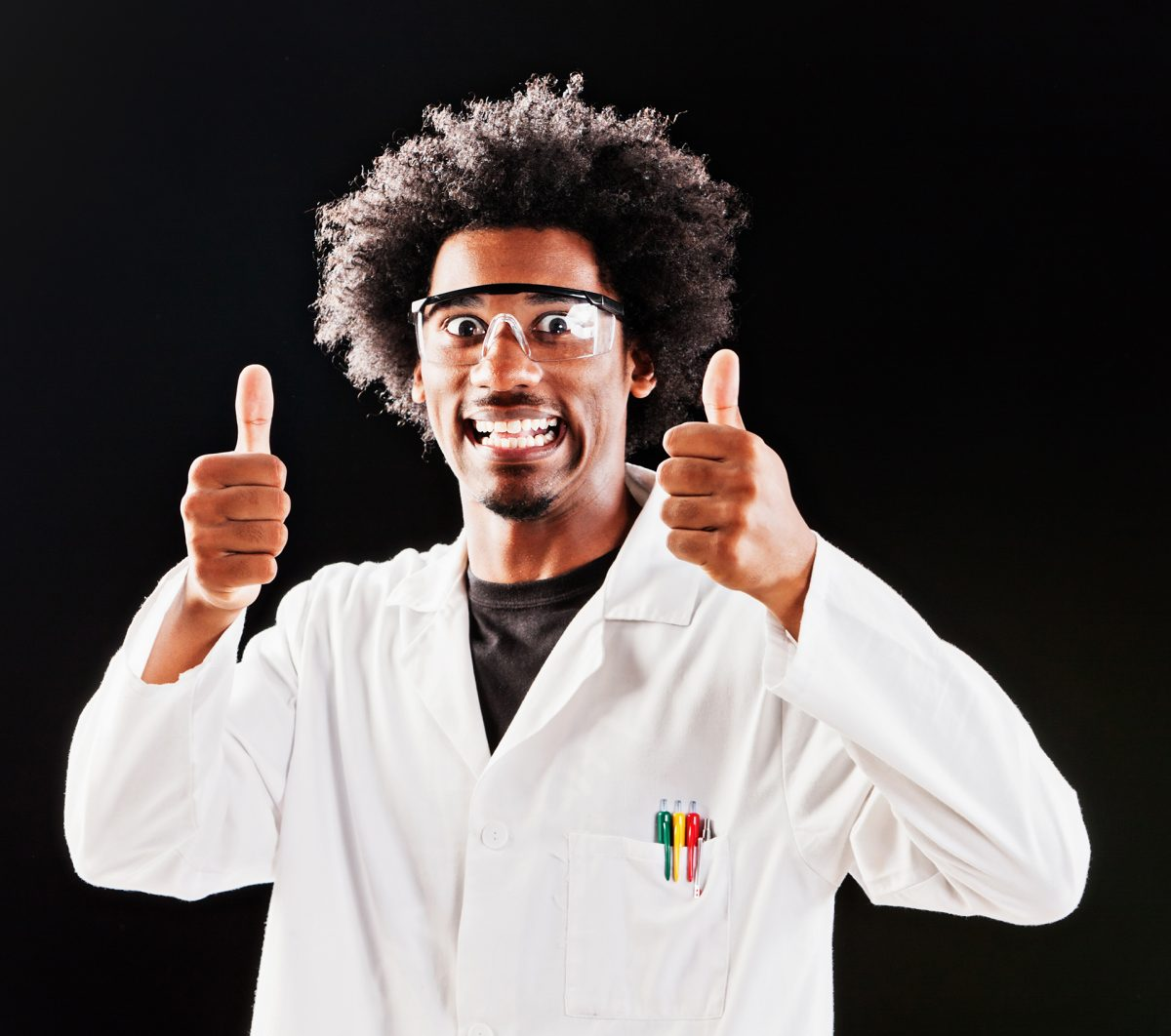 Male scientist giving thumbs up and smiling