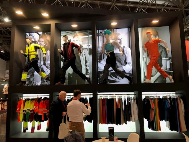 booth at A+A that showcases the variety of colours in european safety apparel