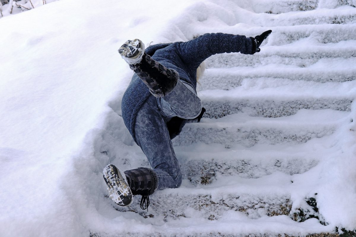 lady falling down icy stairs