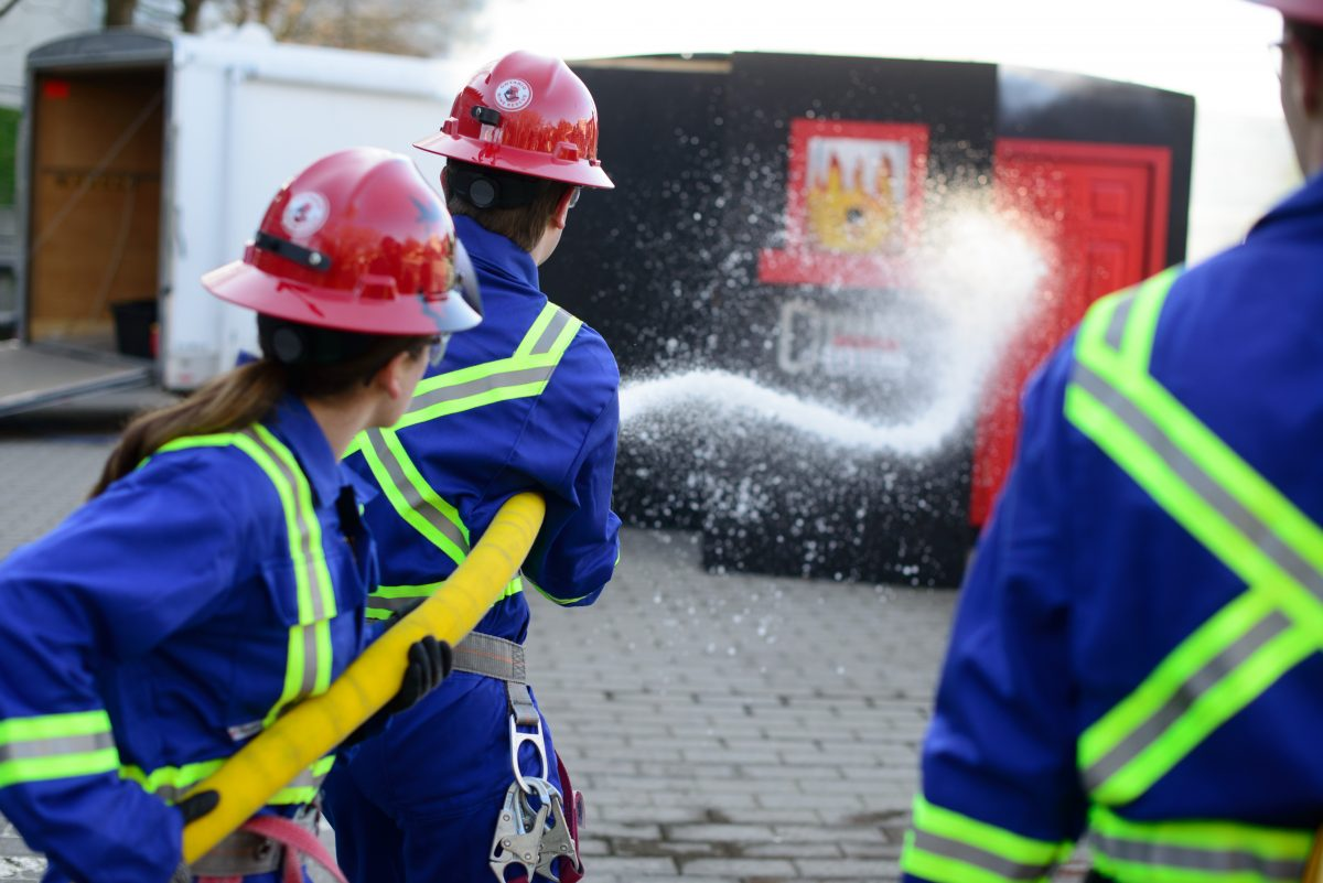 team in mining competition testing their fire fighting skills
