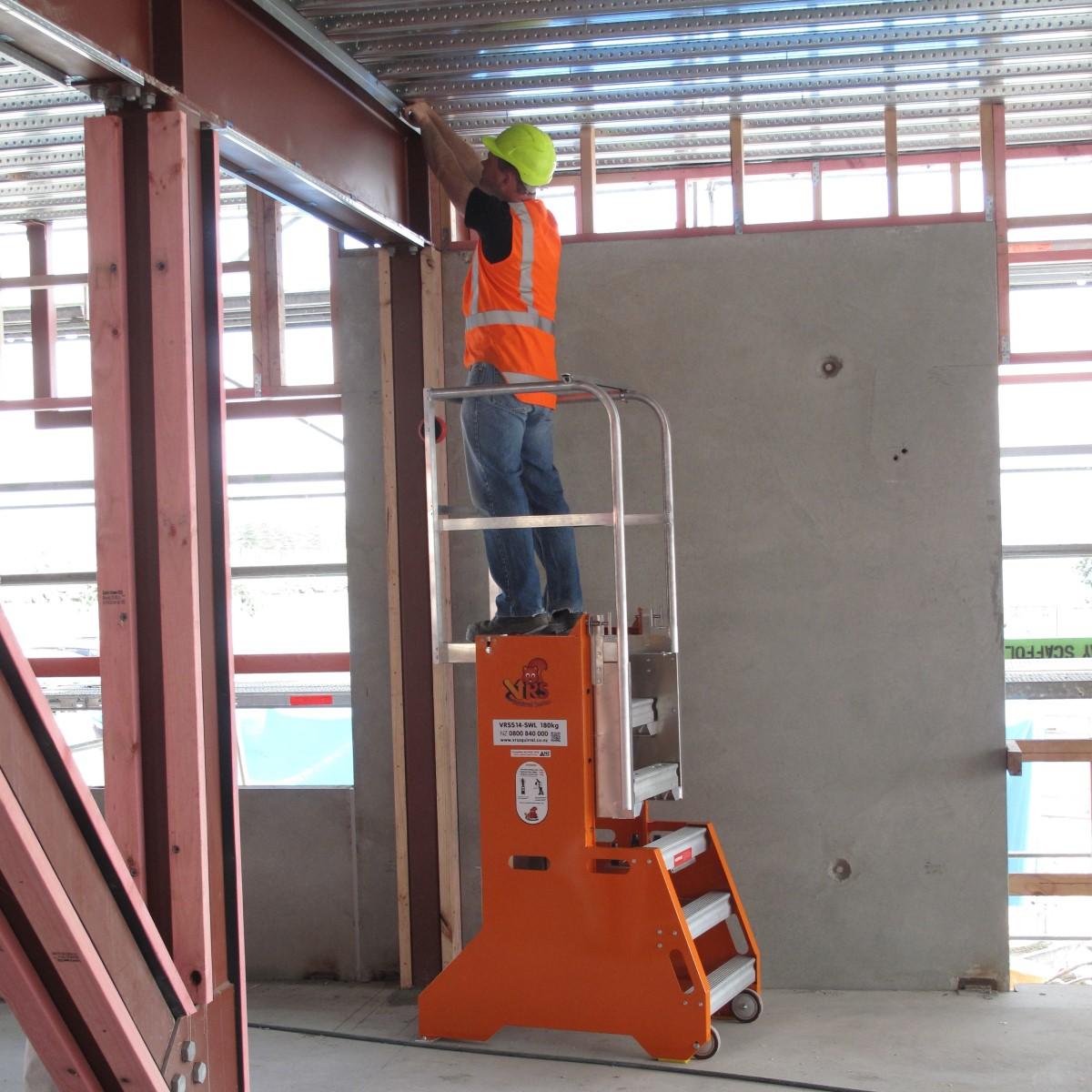 man standing on Equiptec squirrel mobile work platform at construction site