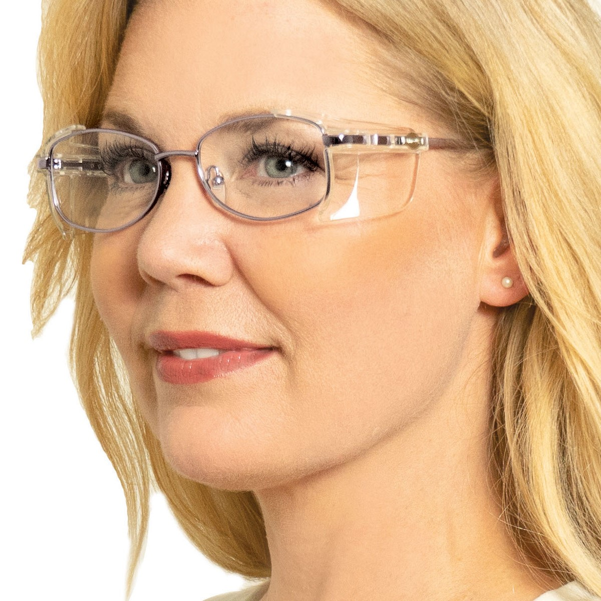 smiling woman wearing prescription safety glasses with side shields