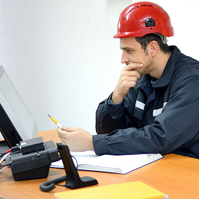 Image of man wearing head protection in the office