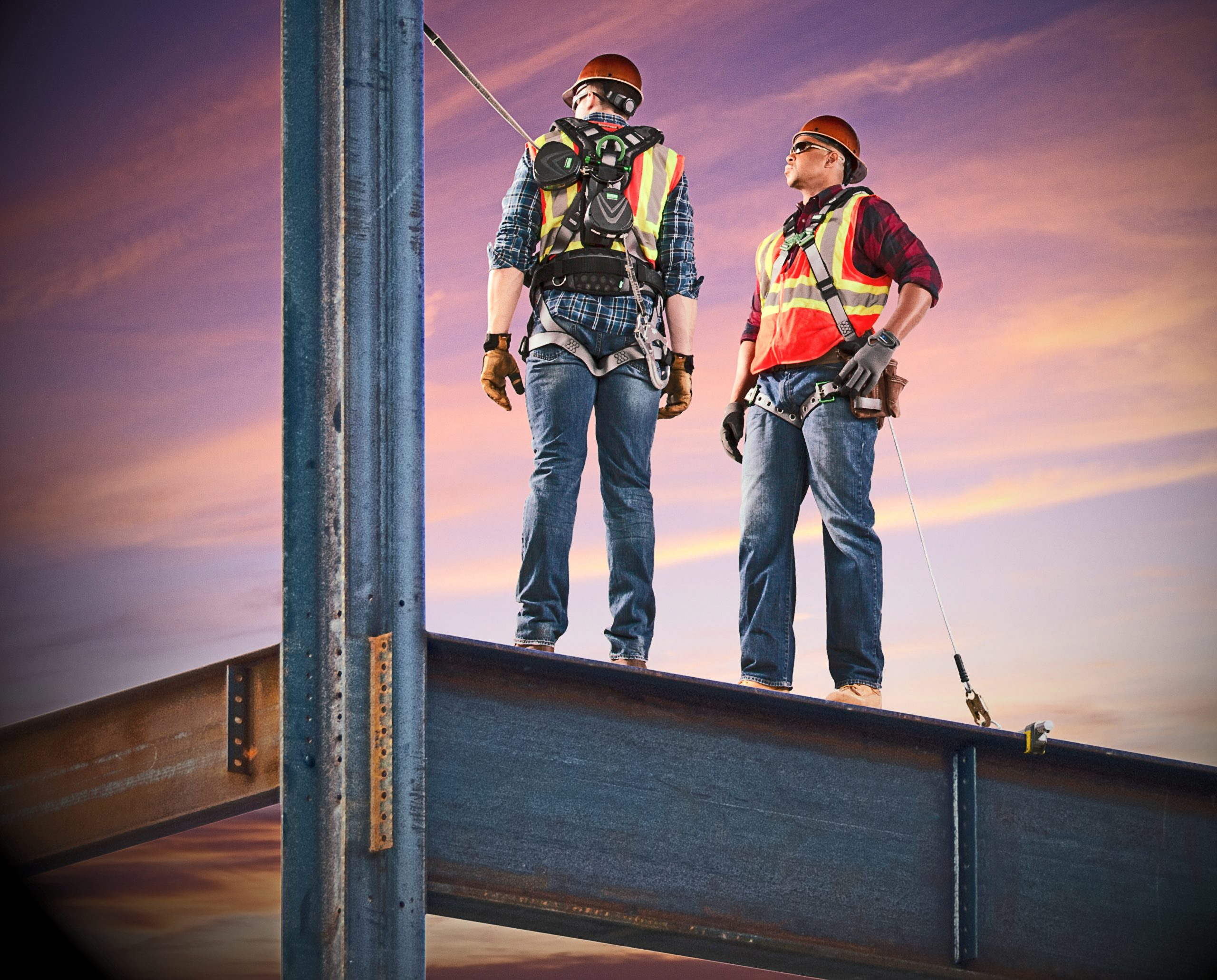 two construction workers wearing v-edge SRLs